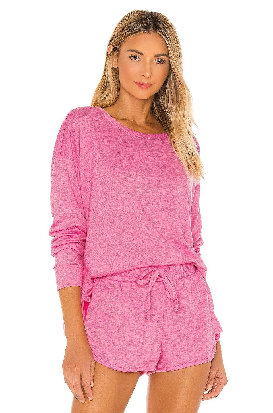 <p>Think pink in this <span>Onzie x Revolve High Low Sweatshirt</span> ($69) and <span>Divine Short</span> ($56).</p>