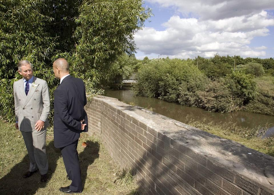 Prince Charles, Prince of Wales views the river that broke its banks when he visits the village of Carcliffe in South Yorkshire to meet emergency service personnel and residents affected by the recent floods brought on by heavy rains.