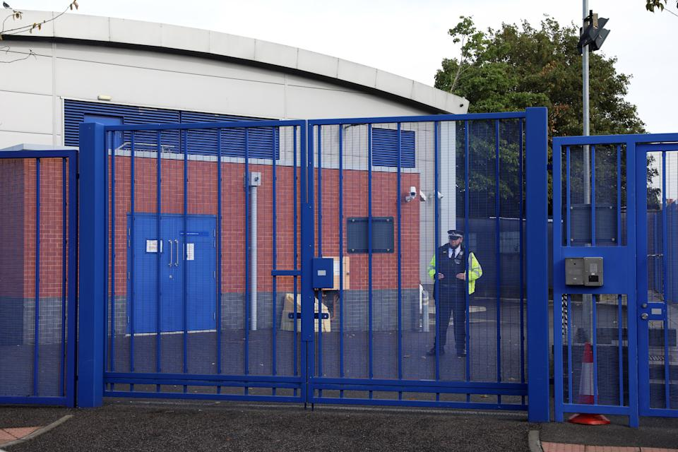 LONDON, ENGLAND - SEPTEMBER 25: A police officer stands guard at Croydon Custody Centre on September 25, 2020 in the Croydon area of London, England. A murder investigation has been launched following the death of a police officer at the Croydon Custody Centre in south London. He was shot by a 23-year-old man who was also treated for a gunshot wound. The officer died later in hospital. The death will be investigated by the  Independent Office for Police Conduct. (Photo by Dan Kitwood/Getty Images)