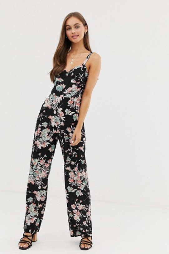 A photo of a model wearing the Brave Soul Cecily floral jumpsuit from ASOS