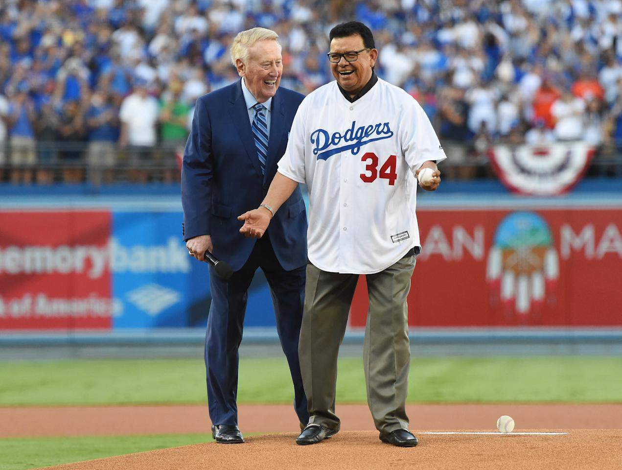 <p>Los Angeles Dodgers former broadcaster Vin Scully (left) hands the ball to former pitcher Fernando Valenzuela for the ceremonial first pitch in game two of the 2017 World Series against the Houston Astros at Dodger Stadium. Mandatory Credit: Jayne Kamin-Oncea-USA TODAY Sports </p>