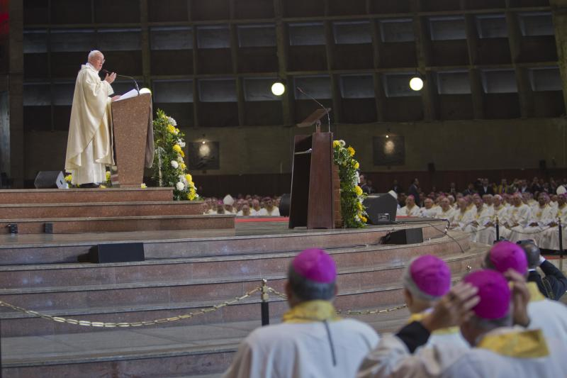 Pope Francis celebrates Mass at Rio de Janeiro's Cathedral, Saturday, July 27, 2013. Pope Francis on Saturday challenged bishops from around the world to get out of their churches and preach, and to have the courage to go to the farthest margins of society to find the faithful. Pope Francis is on the sixth day of his trip to Brazil where he attends the 2013 World Youth Day in Rio. (AP Photo/Domenico Stinellis)