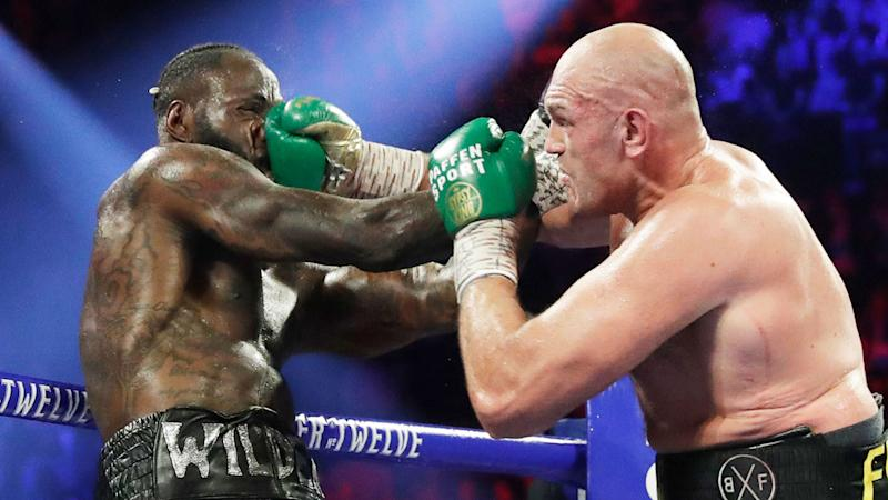 Pictured here, Tyson Fury lands a brutal punch on Deontay Wilder's face.