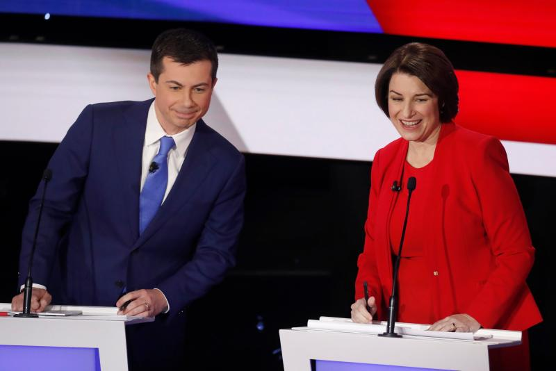 Democratic 2020 U.S. presidential candidates (L-R) former South Bend Mayor Pete Buttigieg and Senator Amy Klobuchar (D-MN) during a commercial break in the seventh Democratic 2020 presidential debate at Drake University in Des Moines, Iowa, U.S., January 14, 2020. REUTERS/Shannon Stapleton