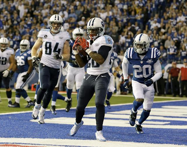 Tennessee Titans' Chris Johnson (28) makes a 1-yard touchdown reception during the second half of an NFL football game against the Indianapolis Colts on Sunday, Dec. 1, 2013, in Indianapolis. (AP Photo/Michael Conroy)