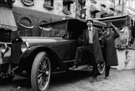<p>Here, two extras are seen posing by an antique car in the East Village on the film set.</p>