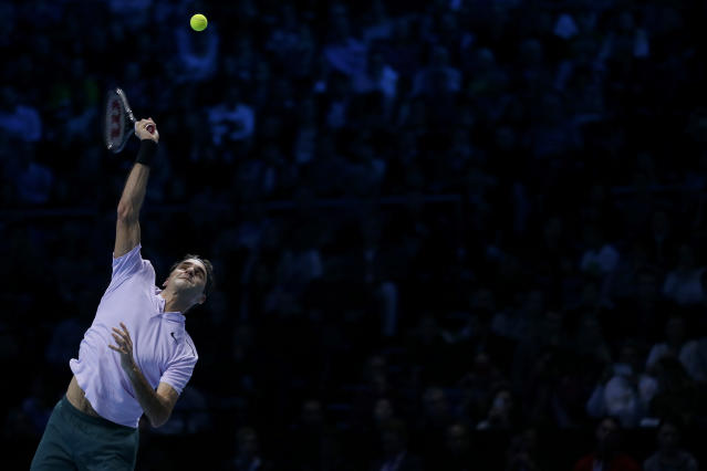 Roger Federer of Switzerland serves to David Goffin of Belgium during their ATP World Tour Finals semifinal tennis match at the O2 Arena in London, Saturday Nov. 18, 2017. (AP Photo/Tim Ireland)
