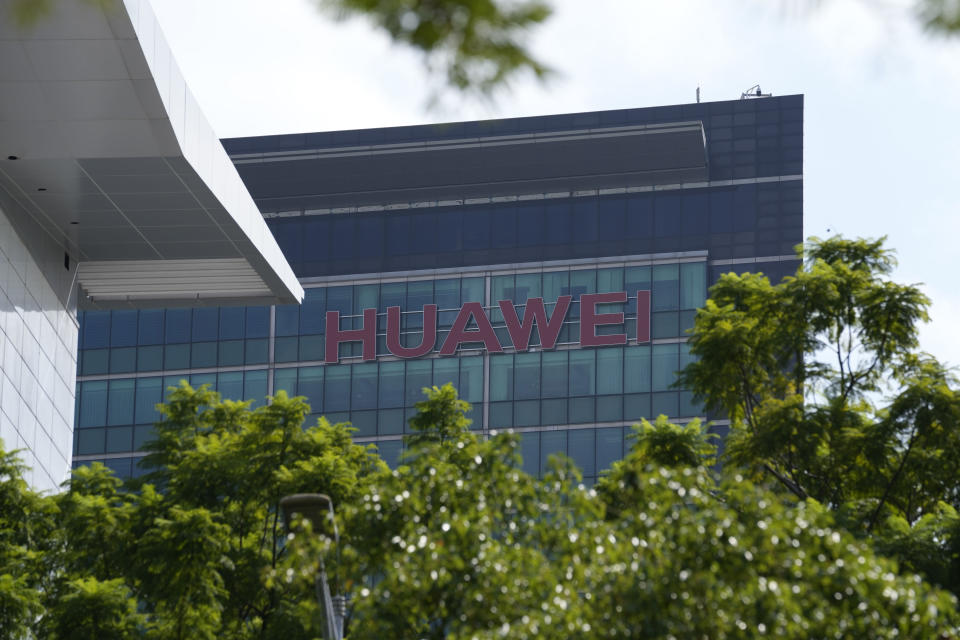 The company logo of Huawei is seen on a building in the sprawling Huawei headquarters campus in Shenzhen, China, Saturday, Sept. 25, 2021. Two Canadians detained in China on spying charges were released from prison and flown out of the country on Friday, Prime Minister Justin Trudeau said, just after a top executive of Chinese communications giant Huawei Technologies reached a deal with the U.S. Justice Department over fraud charges and flew to China. (AP Photo/Ng Han Guan)
