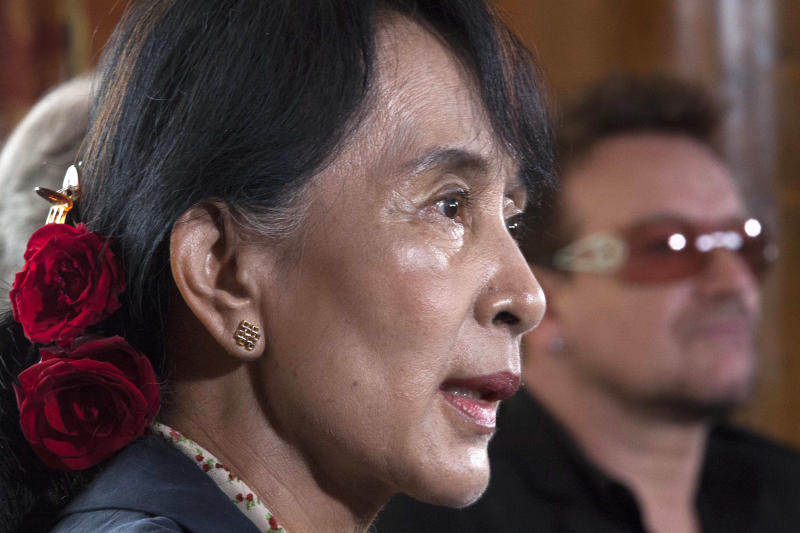 Myanmar's opposition leader Aung San Suu Kyi, left, speaks during a news conference alongside Irish singer and activist Bono after attending a conference of the Oslo Forum at the Losby Gods resort, about 13 kilometers (8 miles) east of Oslo, Monday, June 18, 2012. The Oslo Forum is an international network of armed conflict mediation practitioners. (AP Photo/Markus Schreiber)