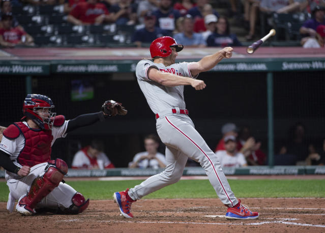 Philadelphia Phillies' Brad Miller, right, has his bat slip from his grip as Cleveland Indians' Roberto Perez watches during the third inning of a baseball game in Cleveland, Sunday, Sept. 22, 2019. (AP Photo/Phil Long)