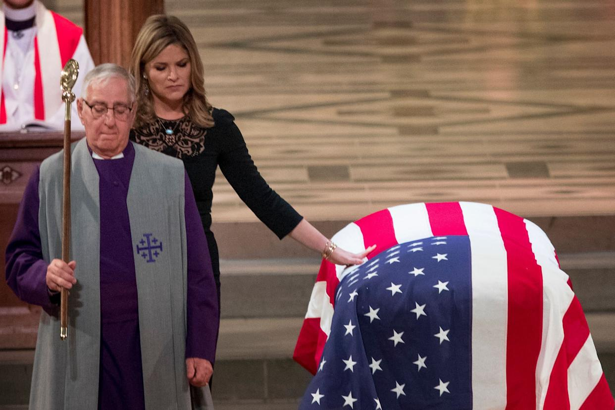 Jenna Bush Hager, the daughter of former President George Bush, touches the casket of former President George H.W. Bush after speaking at his State Funeral.