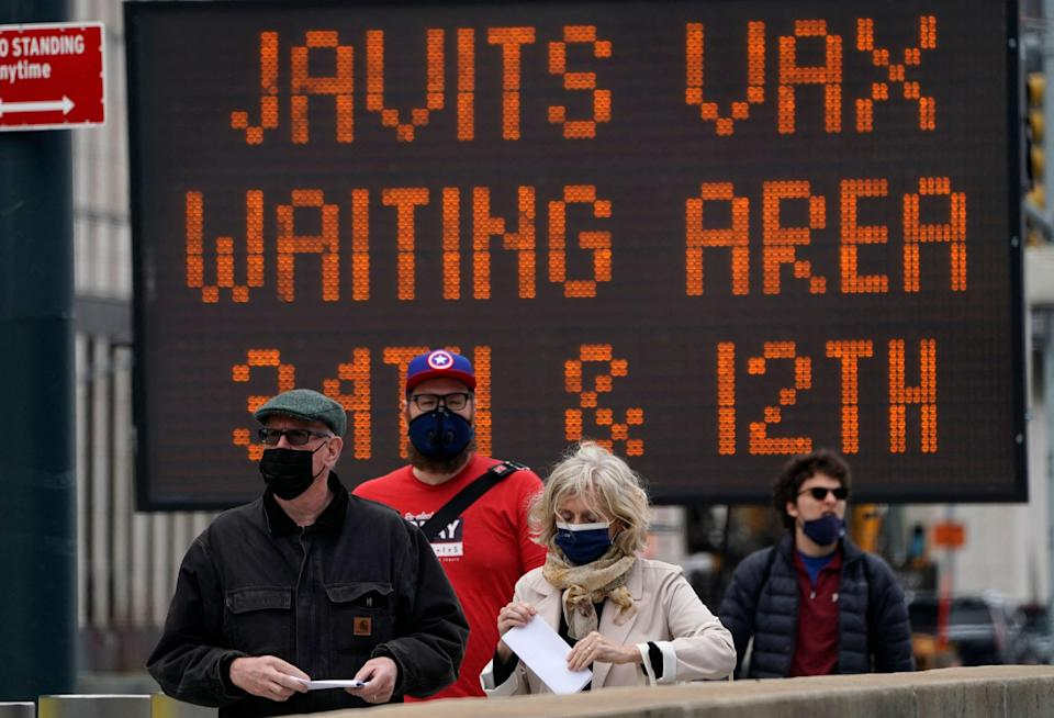 New Yorkers arrive at the Javits Center Covid-19 vaccination center on 13 April 2021 (AFP via Getty Images)