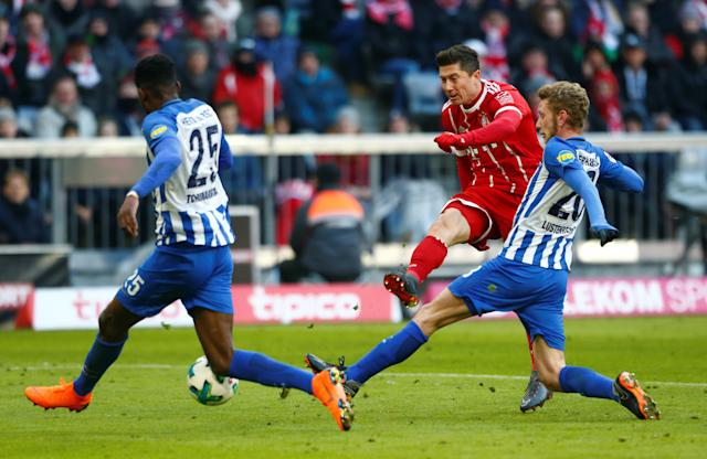Soccer Football - Bundesliga - Bayern Munich vs Hertha BSC - Allianz Arena, Munich, Germany - February 24, 2018 Bayern Munich's Robert Lewandowski shoots at goal REUTERS/Michaela Rehle DFL RULES TO LIMIT THE ONLINE USAGE DURING MATCH TIME TO 15 PICTURES PER GAME. IMAGE SEQUENCES TO SIMULATE VIDEO IS NOT ALLOWED AT ANY TIME. FOR FURTHER QUERIES PLEASE CONTACT DFL DIRECTLY AT + 49 69 650050