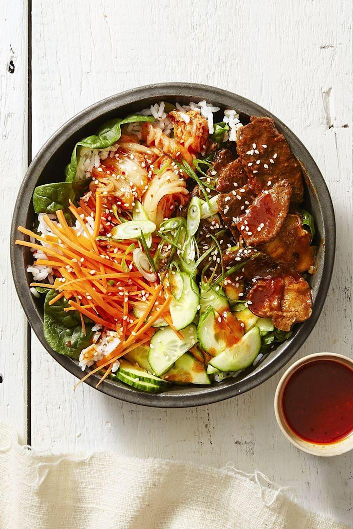 """<p>Korean red pepper paste kicks up the heat on this time-saving <a href=""""https://www.goodhousekeeping.com/food-recipes/healthy/g1364/myplate-inspired-slow-cooker-dinners/"""" rel=""""nofollow noopener"""" target=""""_blank"""" data-ylk=""""slk:slow cooker recipe"""" class=""""link rapid-noclick-resp"""">slow cooker recipe</a>. Bonus: It's also under 500 calories!<br></p><p><a href=""""https://www.goodhousekeeping.com/food-recipes/a42379/spicy-sesame-rice-bowls-recipe/"""" rel=""""nofollow noopener"""" target=""""_blank"""" data-ylk=""""slk:Get the recipe for Spicy Sesame Rice Bowls »"""" class=""""link rapid-noclick-resp""""><em>Get the recipe for Spicy Sesame Rice Bowls »</em></a></p>"""