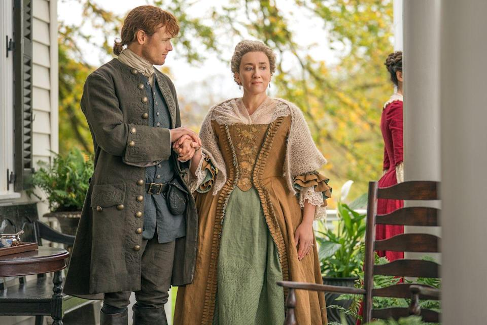 """<p>As fans know, season four was about the couple settling down with their family in North Carolina. Instead of filming in the state, <a href=""""https://parade.com/962428/lesley_chen/outlander-filming-locations/"""" rel=""""nofollow noopener"""" target=""""_blank"""" data-ylk=""""slk:they created and found sets in Scotland"""" class=""""link rapid-noclick-resp"""">they created and found sets in Scotland </a>that resembled the landscape of North America and North Carolina.</p>"""