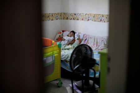Daniel Vieira, who is two years old, and was born with microcephaly, sleeps at his home in Olinda, Brazil, August 7, 2018. REUTERS/Ueslei Marcelino/Files