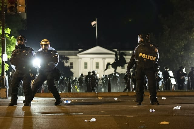 Police form a line on H Street as demonstrators gather near the White House in Washington (Alex Brandon/AP)