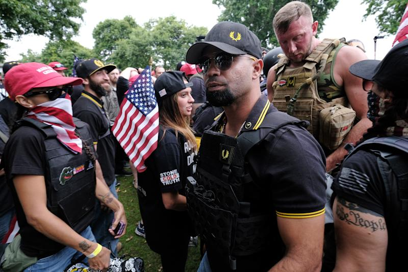 Proud Boys head Enrique Tarrio (center, wearing sunglasses at a rally last weekend in Portland, Oregon. (Photo: Anadolu Agency via Getty Images)
