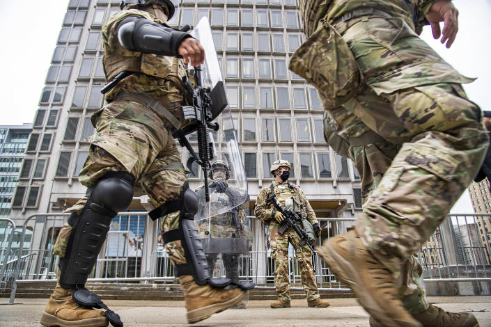 Members of the National Guard stand in guard in front of the Philadelphia Municipal Services Building in Philadelphia, Pa., Friday, Oct. 30, 2020. (Jose F. Moreno/The Philadelphia Inquirer via AP)