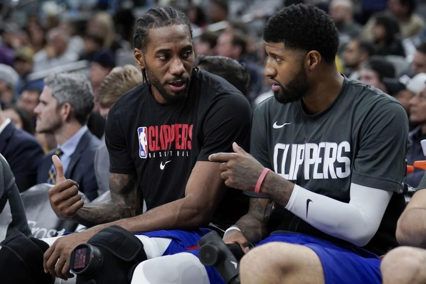 FILE - In this Dec. 21, 2019, file photo, Los Angeles Clippers' Kawhi Leonard, left, and Paul George.