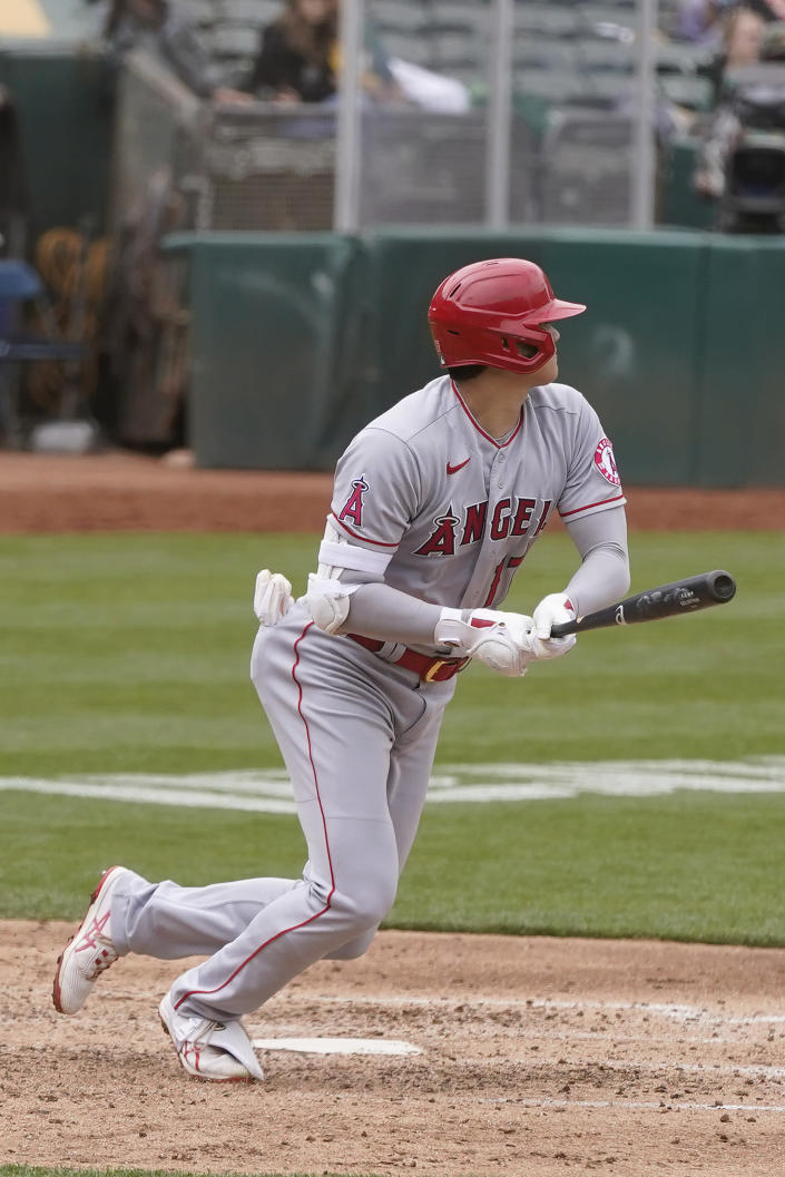 Los Angeles Angels' Shohei Ohtani hits a two-run single against the Oakland Athletics during the fifth inning of a baseball game in Oakland, Calif., Saturday, May 29, 2021. (AP Photo/Jeff Chiu)