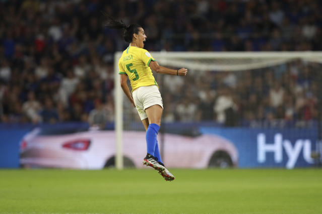 Brazil's Thaisa celebrates after scoring scores her side's first goal during the Women's World Cup round of 16 soccer match between France and Brazil at the Oceane stadium in Le Havre, France, Sunday, June 23, 2019. (AP Photo/Francisco Seco)