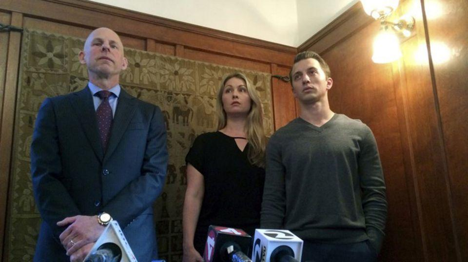 Attorney Anthony Douglas Rappaport, left, speaks at a news conference with his clients, Denise Huskins and her boyfriend Aaron Quinn. Source: AP