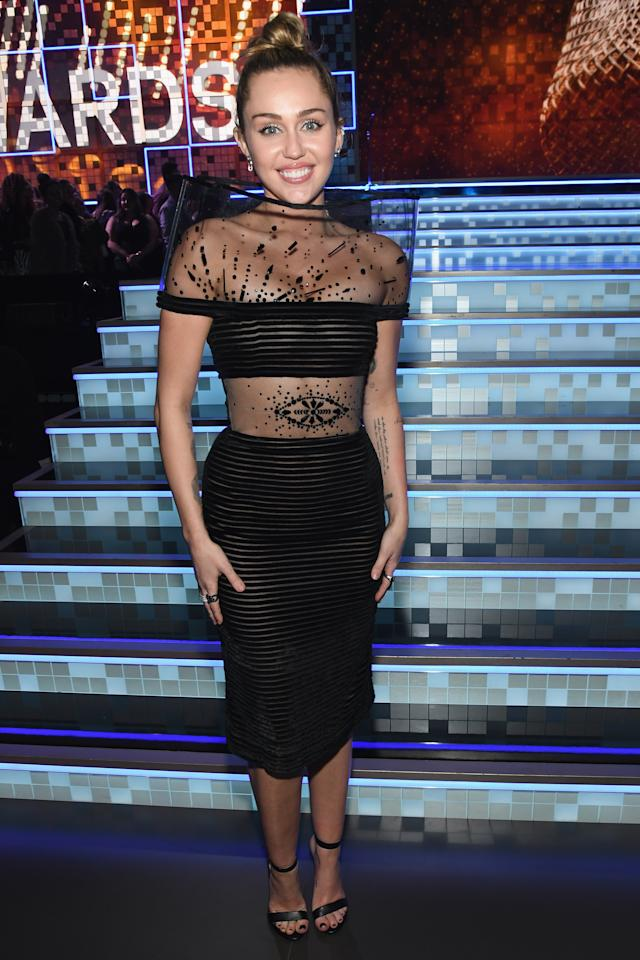 <p>Cyrus ditched her Mugler pantsuit for a sheer dress by Jean Paul Gaultier. (Image via Getty Images) </p>