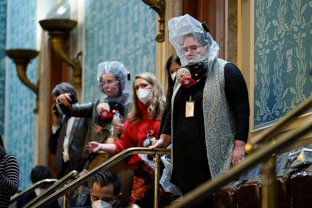 PHOTO: People shelter in the House gallery as protesters try to break into the House Chamber at the U.S. Capitol on Wednesday, Jan. 6, 2021, in Washington.  (Andrew Harnik/AP)