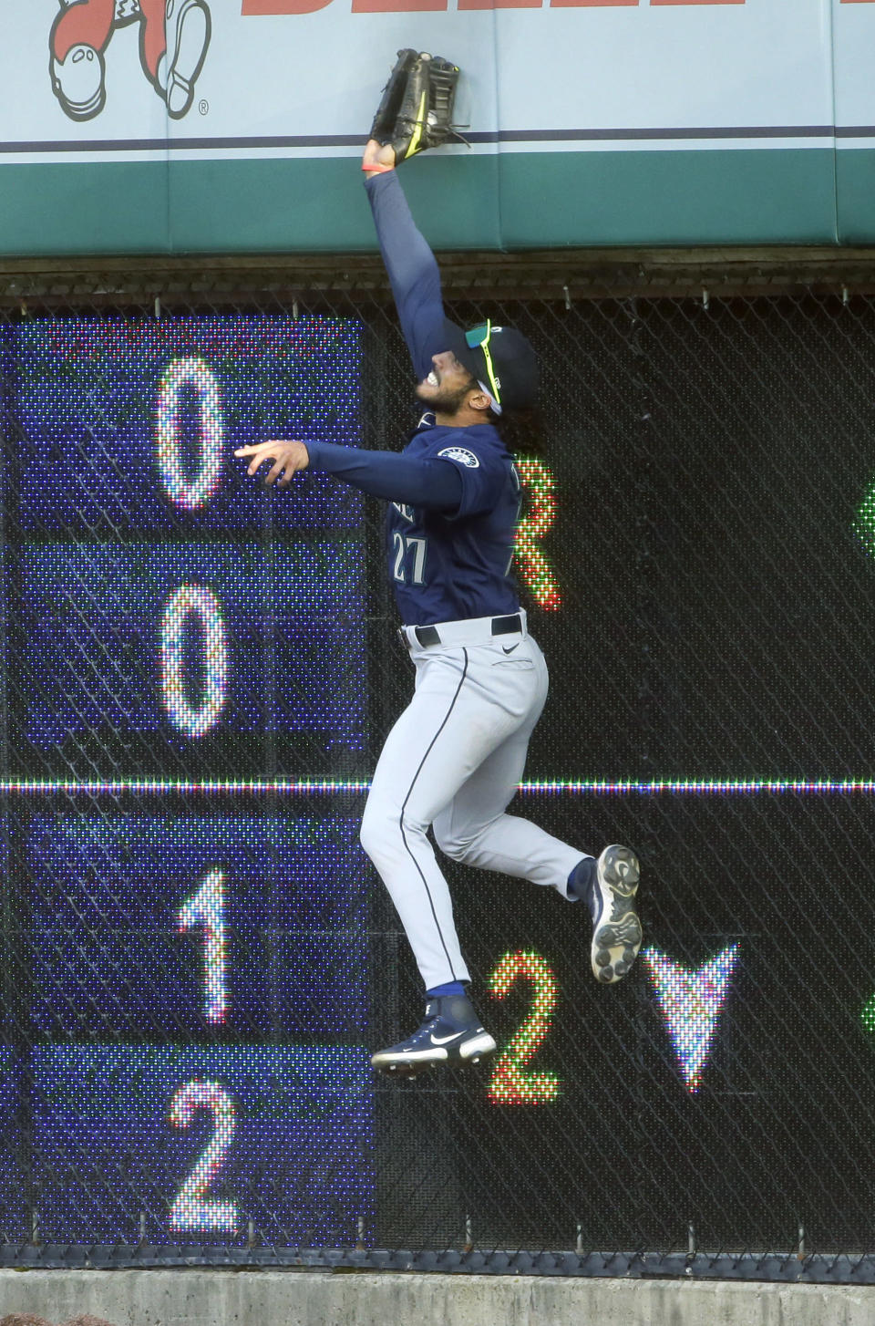 Seattle Mariners right fielder Dillon Thomas goes up against the scoreboard to catch a fly ball hit by Detroit Tigers' Niko Goodrum during the second inning of a baseball game Wednesday, June 9, 2021, in Detroit. (AP Photo/Duane Burleson)