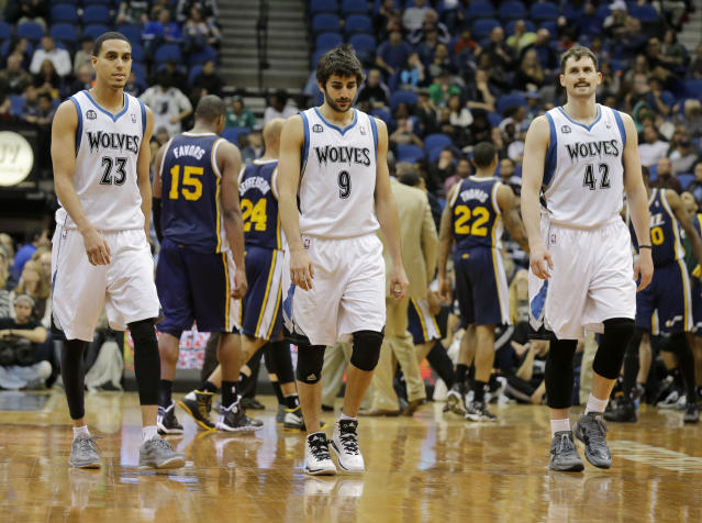 Minnesota Timberwolves guard Kevin Martin (23), guard Ricky Rubio (9), of Spain, and forward Kevin Love (42) head downcourt during a timeout in overtime of an NBA basketball game as the Utah Jazz take the lead in Minneapolis, Wednesday, April 16, 2014. The Jazz won 136-130 in double overtime. (AP Photo/Ann Heisenfelt)