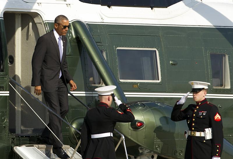 President Barack Obama steps off Marine One, upon his arrival at Andrews Air Force Base, Md in November. (Photo: Jose Luis Magana/AP)