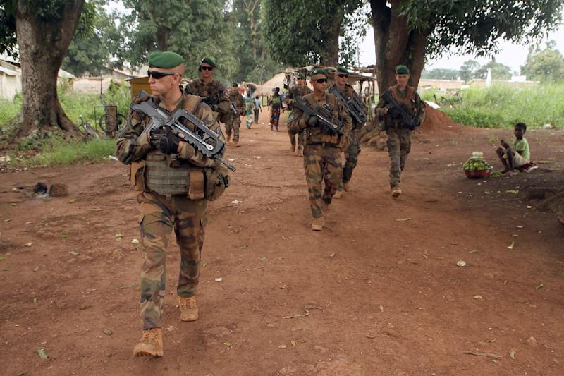 Soldiers from the French Foreign Legion taking part in Operation Sangaris patrol the market in Sibut, north of Bangui, on September 25, 2015 (AFP Photo/Edouard Dropsy)