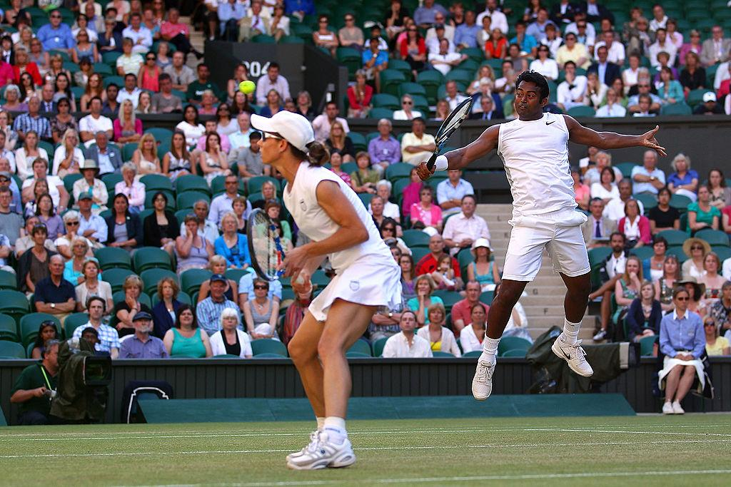 <p>Leander Paes wins the Mixed Doubles final at Wimbledon. He created history by becoming the second man to win three different Wimbledon titles in three different decades. </p>