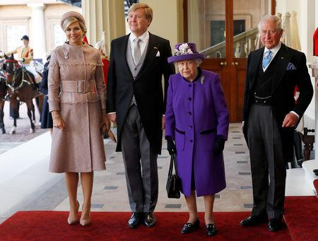 Britain's Queen Elizabeth and Prince Charles, and King Willem-Alexander and Queen Maxima of the Netherlands arrive at Buckingham Palace, in London, Britain October 23, 2018. REUTERS/Peter Nicholls