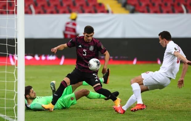 Canada's Olympic hopes were shattered following a 2-0 loss to Mexico in a men's Olympic soccer qualification match on Sunday.   (Henry Romero/Reuters - image credit)
