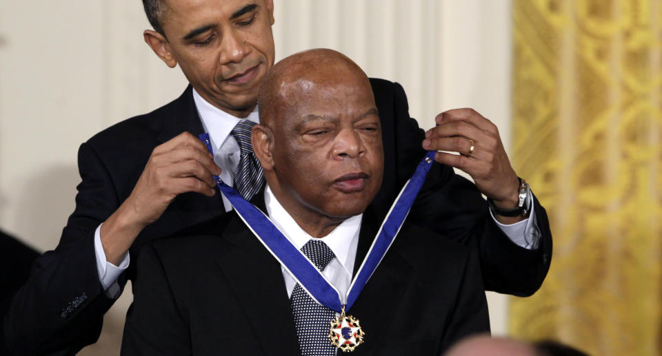 President Barack Obama presents a 2010 Presidential Medal of Freedom to U.S. Rep. John Lewis, D-Ga., during a ceremony in the East Room of the White House in Washington. Lewis, who carried the struggle against racial discrimination from Southern battlegrounds of the 1960s to the halls of Congress, died Friday, July 17, 2020.