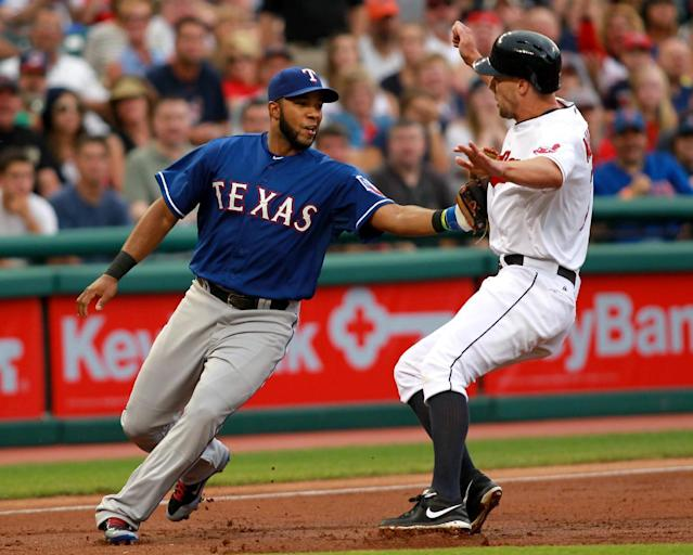 Texas Rangers' Elvis Andrus, left, tags out Cleveland Indians' David Murphy at third base in the second inning of a baseball game Friday, Aug. 1, 2014, in Cleveland. (AP Photo/Aaron Josefczyk)