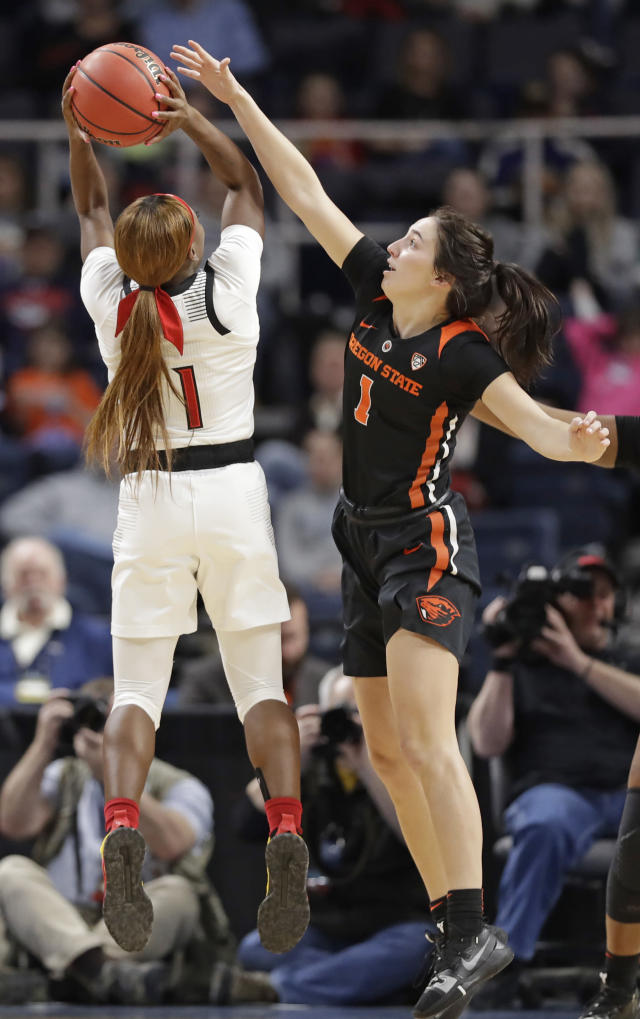 Oregon State guard Aleah Goodman (1) defends Louisville guard Dana Evans (1) during the first half of a regional semifinal game in the NCAA women's college basketball tournament, Friday, March 29, 2019, in Albany, N.Y. (AP Photo/Kathy Willens)