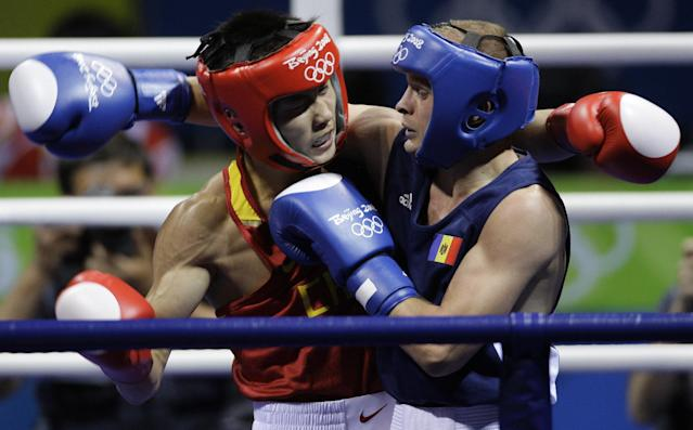 Olympic boxers started wearing headgear in 1984. (AP)
