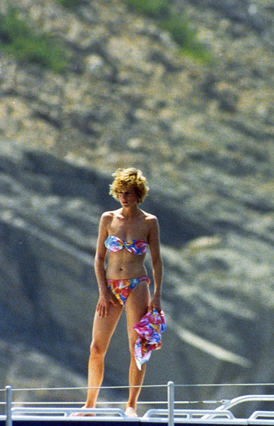 <p>Princess Diana and Prince Charles took young Princes William and Harry on holiday to Mallorca in 1987, where they joined the Spanish royal family. Diana returned the following year and was spotted enjoying a boat ride in a multicolored bikini.</p>