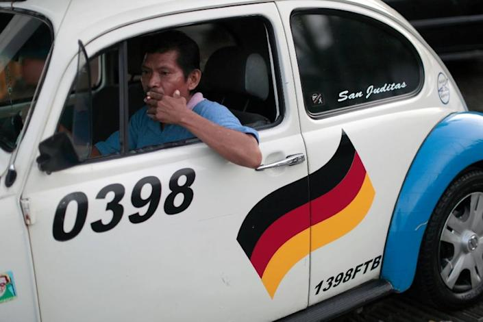Beetle aficionados can still find a few Beetle taxis but they have to venture into tourist towns such as Acapulco (AFP Photo/Pedro Pardo )