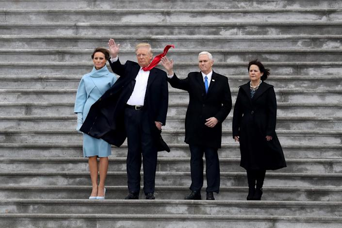 <p>First Lady Melania Trump, President Donald Trump, Vice President Mike Pence and Karen Pence wave goodbye to Barack and Michelle Obama on the West Front of the U.S. Capitol on January 20, 2017 in Washington, DC. (Photo: Rob Carr/Getty Images) </p>