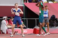 <p>Karsten Warholm of Team Norway and Alison dos Santos of Team Brazil react after finishing first and third respectively in the Men's 400m Hurdles Final on day eleven of the Tokyo 2020 Olympic Games at Olympic Stadium on August 03, 2021 in Tokyo, Japan. (Photo by Patrick Smith/Getty Images)</p>