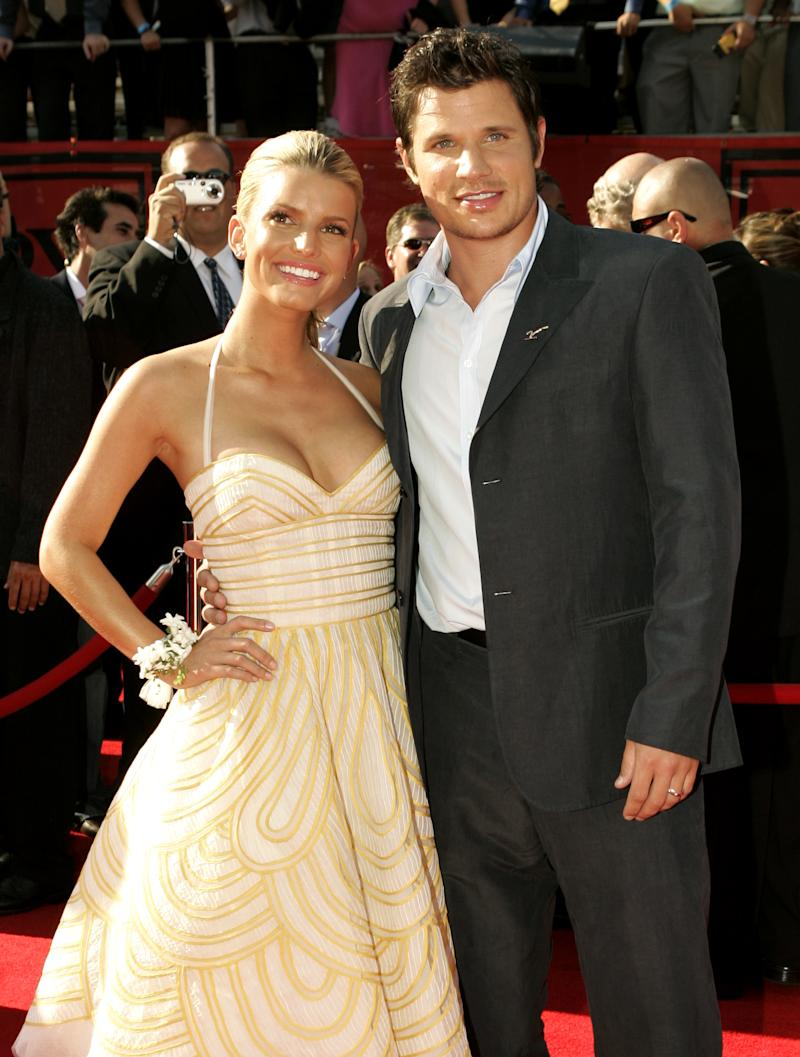 Singer and actress Jessica Simpson (L) and husband, singer Nick Lachey, pose as they arrive at the 13th annual ESPY Awards at the Kodak Theatre in Hollywood July 13, 2005. The taped program which honors excellence in sports performance will air on ESPN on July 17, 2005. REUTERS/Robert Galbraith FSP/JK