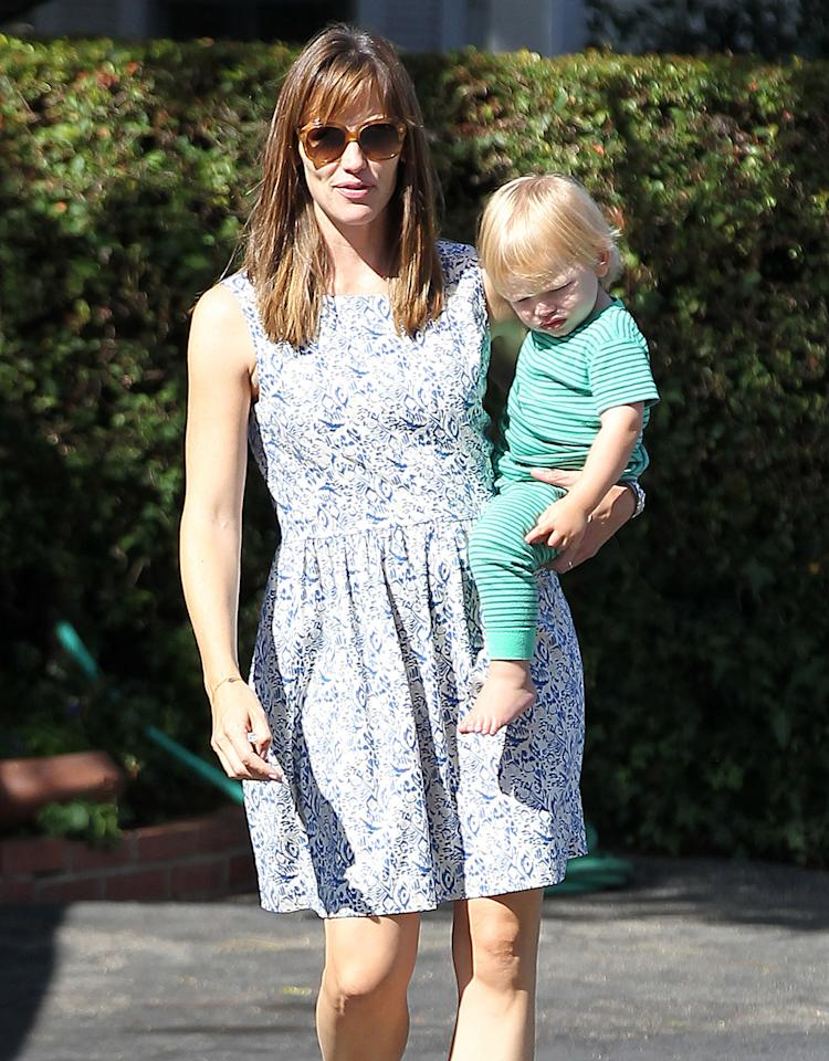 While the gossip world was abuzz over Jennifer Garner's new style (bangs!), her sweet-faced son Samuel didn't seem to notice a thing as they did the school run for his big sisters in Pacific Palisades, California. (8/21/2013)