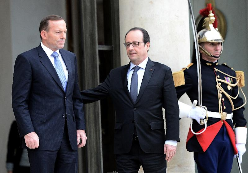 French President Francois Hollande (centre) held talks with Australian Prime Minister Tony Abbott at the Elysee Palace in Paris, on April 27, 2015