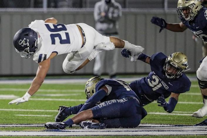 Bellflower, CA, Saturday March 13, 2021 - Sierra Canyon running back Anthony Spearman is tripped up by St. John Bosco defenders during a first half drive at Panish Family Stadium. (Robert Gauthier/Los Angeles Times)