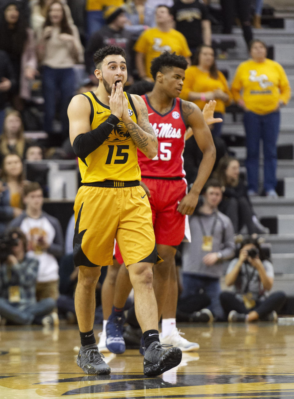 Missouri's Jordan Geist, left, reacts after getting a foul called on him in front of Mississippi's Luis Rodriguez, right, during the first half of an NCAA college basketball game Saturday, March 9, 2019, in Columbia, Mo. (AP Photo/L.G. Patterson)