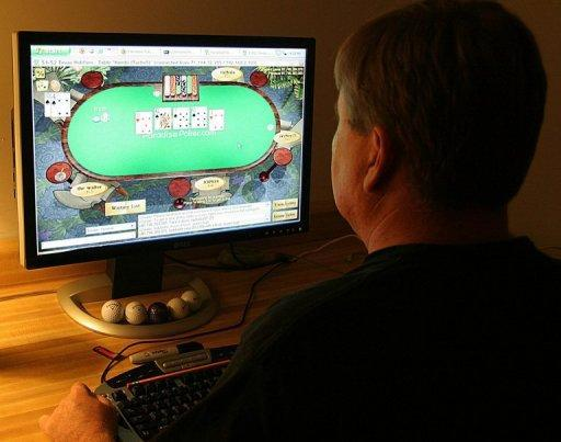 A man plays poker on an Internet gaming site from his home in Manassas, Virginia. Despite a new crackdown on Internet gambling this week, the US government appears to be easing its stand on many forms of online betting, prompting states to swing into action to tap a new revenue source